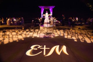 gobo-lighting-dance-floor-projection-at-poolside-wedding