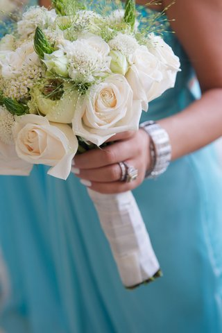 joanna-krupas-bridesmaid-holds-white-rose-bouquet