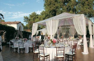 white-reception-tent-covers-tables-in-backyard