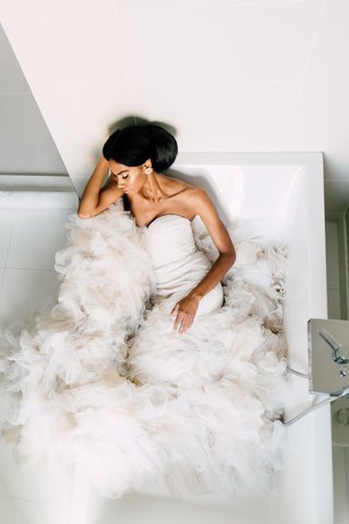 inbal-dror-fluffy-mermaid-gown-african-american-model-posed-in-bathtub-with-train-spilling-out