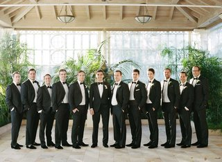 groomsmen-in-tuxedos-and-black-bow-ties-at-palm-beach-wedding-venue
