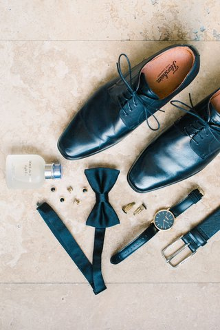 groom-accessories-black-dress-shoes-black-leather-belt-black-watch-bow-tie-cufflinks-cologne