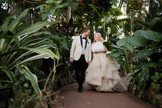 bride-in-martina-liana-layered-blush-ballgown-with-groom-in-cream-tuxedo-jacket-greenhouse