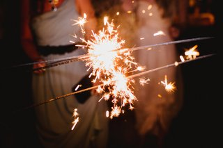 wedding-guests-holding-sparkler-fireworks-at-night