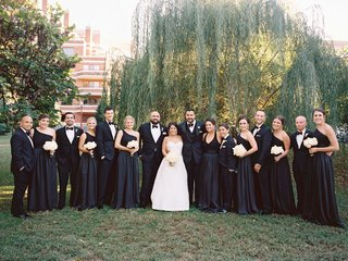 bridesmaids-in-black-bridesmaid-dresses-groomsmen-in-black-and-white-tuxedos-white-bouquets