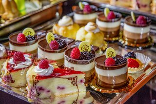 silver-platter-topped-with-berry-desserts-and-treats