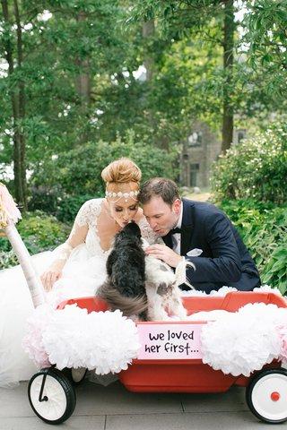 bride-in-hayley-paige-headpiece-groom-in-ike-behar-puppies-in-wagon