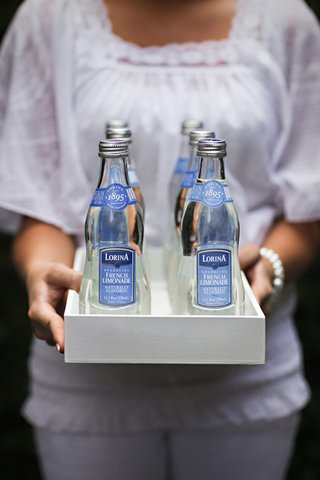 bottles-of-sparkling-lemonade-on-white-tray