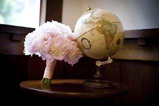soft-pink-peony-bouquet-next-to-globe