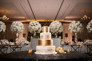 four-layer-wedding-cake-white-and-gold-layers-with-large-initial-cake-topper-drip-and-design-detail