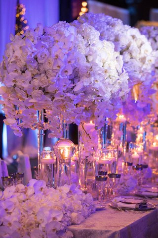 wedding-reception-flower-runner-on-table-end-candles-white-rose-orchid-centerpieces