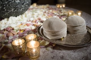 suede-kippa-pile-on-silver-platter-next-to-candles