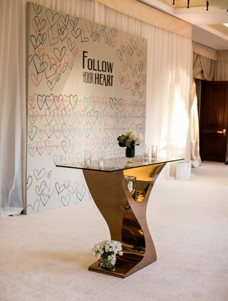 wedding-reception-unique-escort-card-ideas-hearts-colorful-follow-your-heart