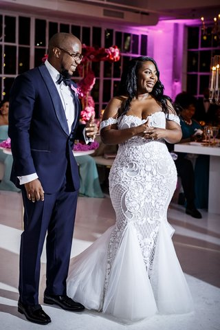 bride-in-mermaid-dress-and-groom-in-tuxedo-african-american-couple-off-shoulder-gown-reception