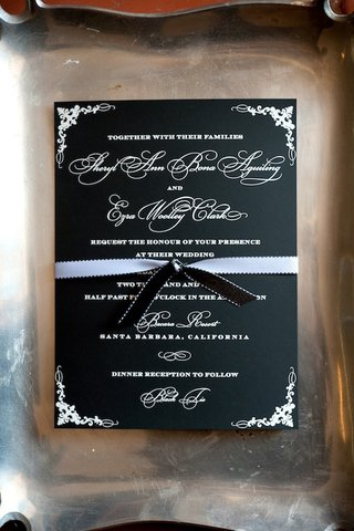 black-wedding-invite-with-white-type-and-ribbon