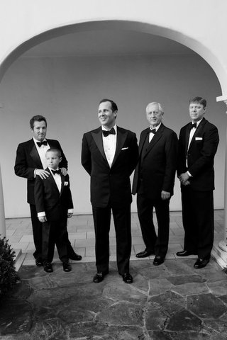 black-and-white-photo-of-groom-with-male-guests-in-tuxes