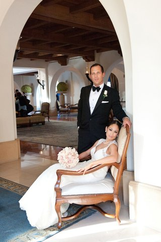 bride-on-throne-in-hotel-with-tuxedo-groom