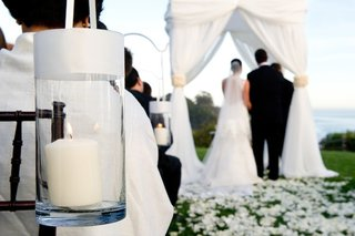 bride-and-groom-in-background-at-outdoor-wedding-ceremony