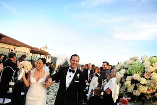 bride-and-groom-walk-up-aisle-at-outdoor-wedding