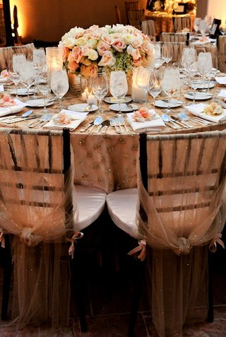 sheer-fabric-with-sequins-covering-wedding-reception-chairs