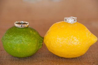 wedding-ring-on-lime-and-engagement-ring-on-lemon