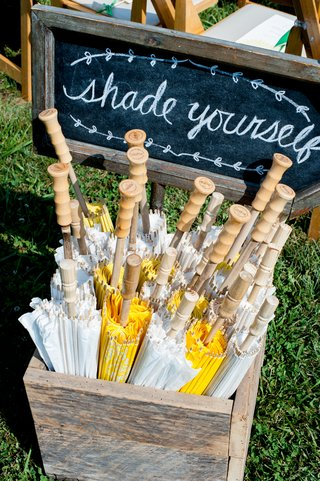 shade-yourself-sign-with-yellow-and-white-ceremony-parasols