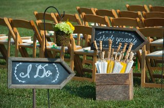 wood-ceremony-chair-at-outdoor-wedding-and-chalkboard-signs