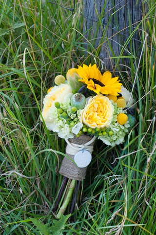 green-and-yellow-bridal-bouquet-wrapped-in-burlap