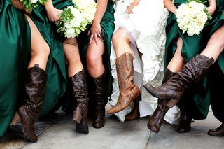 bridesmaids-and-bride-at-rustic-wedding-with-cowboy-boots