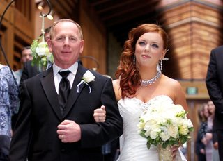 red-hair-bride-walks-down-aisle-with-father-of-bride