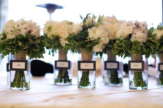 white-flower-bouquet-with-greenery-in-vases