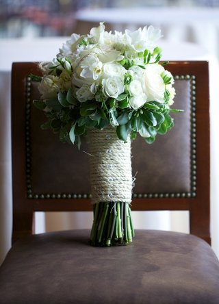 white-rose-bouquet-with-green-leaves-and-twine