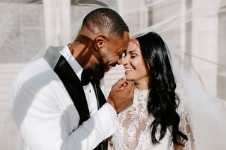 r-b-singer-tankr-zena-foster-wedding-bride-and-groom-pose-under-veil