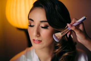 bride-getting-makeup-done-bridal-makeup-inspiration-natural-lipstick