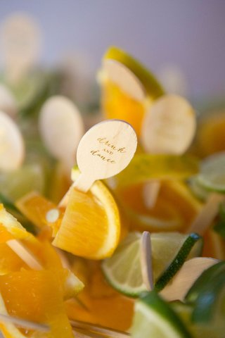 drink-stirrers-and-garnish-wood-pieces-drink-dance-on-slices-of-orange-and-lime-fruit-garnishes