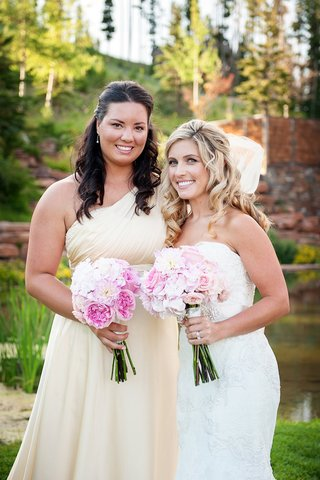 bride-in-strapless-watters-gown-with-bridesmaid-in-vera-wang-one-shoulder-bridesmaid-dress