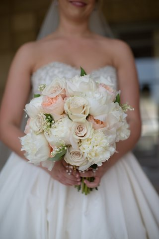 brides-bouquet-of-white-and-peach-peonies-white-roses-and-pale-pink-roses