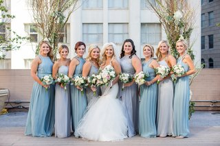 bride-in-blush-by-hayley-paige-bridesmaids-in-dusty-blue-and-silver