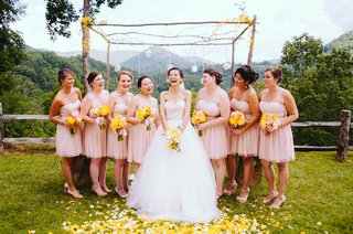 bride-with-bridesmaids-in-front-of-wedding-altar