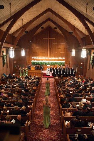 bridesmaids-in-strapless-floor-length-green-dresses-walk-down-united-methodist-church-aisle