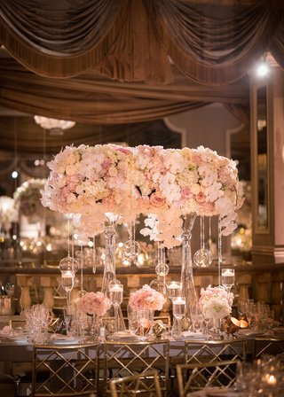 wedding-reception-rectangular-table-gold-chairs-high-and-low-centerpiece-designs-pink-rose-orchid