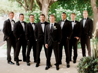 groomsmen-in-suits-and-bow-ties-and-groom-in-regular-tie-white-boutonniere