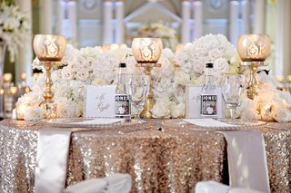 sweetheart-table-with-jones-soda-bottles-and-gold-tablecloth