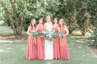 bride-in-lace-illusion-long-sleeve-wedding-dress-bridesmaids-in-long-pink-red-bridesmaid-dresses