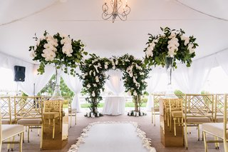 wedding-ceremony-tent-white-gold-greenery-color-palette-orchid-leaves-trees-gold-chairs