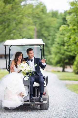 wedding-ceremony-exit-bride-in-trumpet-gown-and-groom-in-tuxedo-on-back-of-golf-cart-new-york