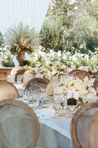 white-and-taupe-table-linens-with-white-wedding-centerpiece