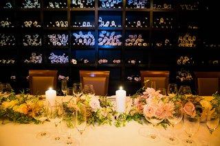 small-wedding-reception-in-the-wine-cellar-of-del-pasto-with-pastel-pink-orange-dahlias-roses