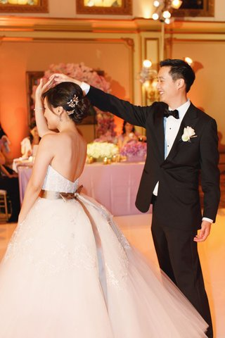 groom-spins-bride-during-dance