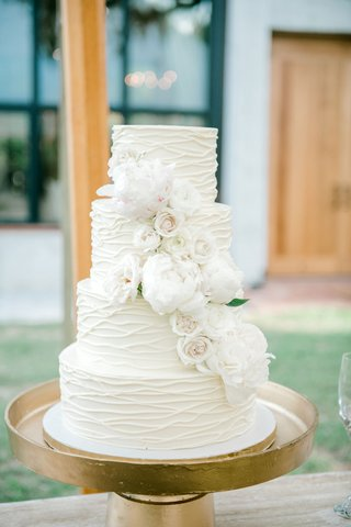 wedding-cake-four-layer-white-cake-with-white-rose-and-peony-flowers-gold-stand-textured